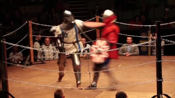 Medieval knight fighting, reconstruction of medieval battles. Full contact knight fighting.