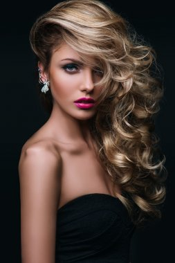 Beauty girl with blond curly hair