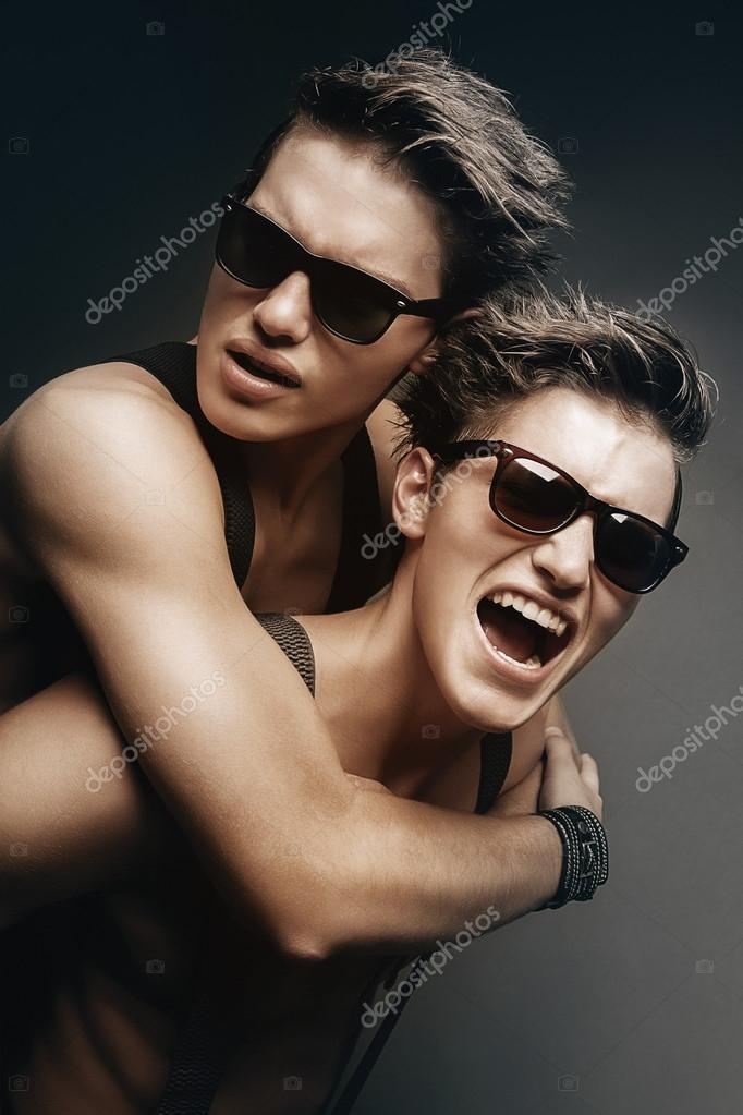 Two smiling brothers in sunglasses
