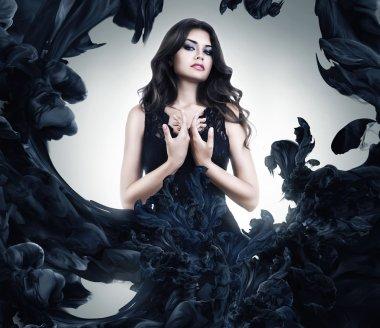 Beautiful sexy woman in black dress