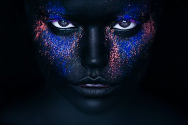 Girl in black paint