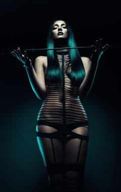 bdsm woman with whip