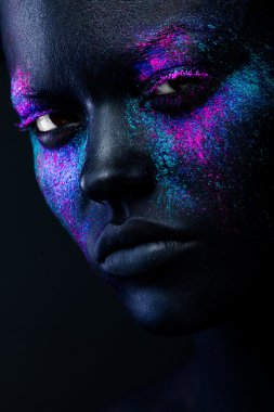 Black woman face with neon make-up