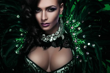 woman in green feathers