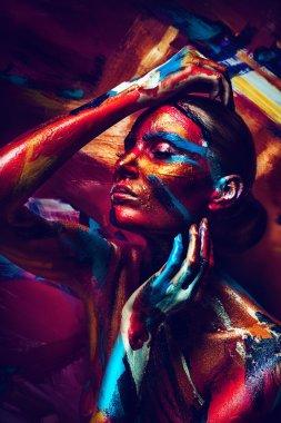 Sensual girl with colorful bodyart