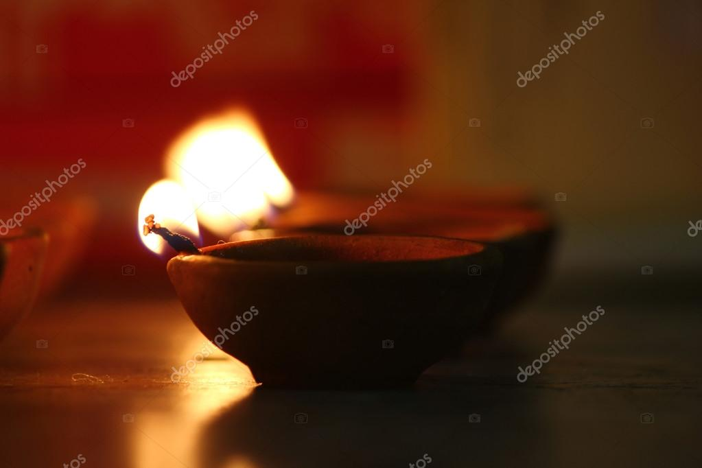 Traditional oil lamps lit on the occasion of Diwali festival
