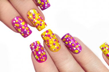 Multicolored manicure with dots.