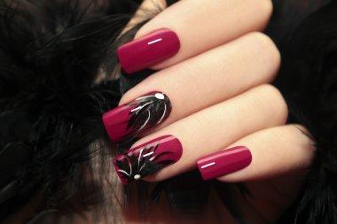 Burgundy manicure.