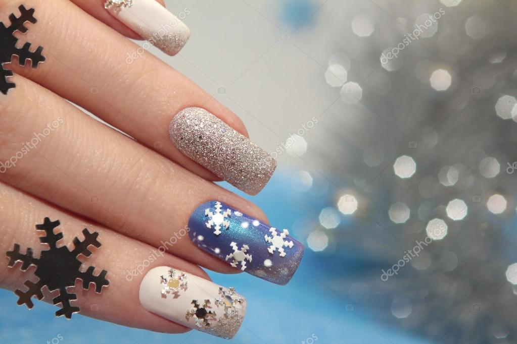 Manicure with snowflakes. — Stock Photo © marigo #58502635