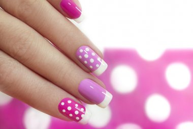 Nail design with white dots.