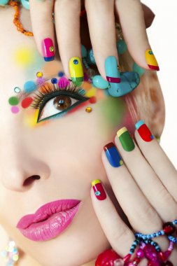 Colorful French manicure and makeup.