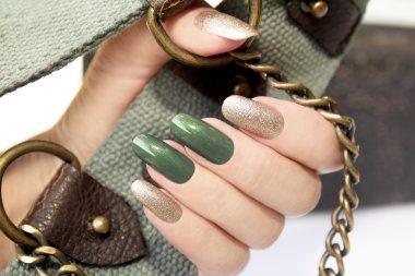 Green silver manicure.