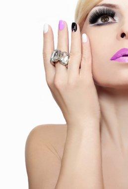 Makeup with pink lips and nail Polish.