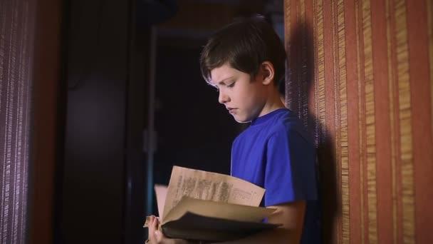 teen boy reading book education is wall indoor