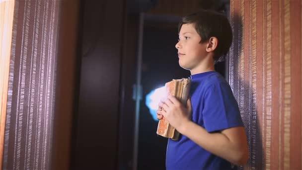boy teen book reading is wall education indoor lifestyle