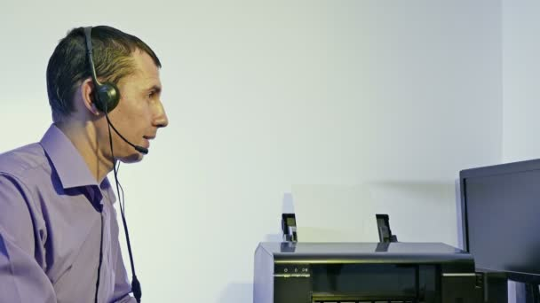 working man in call center support for computer with headphones and microphone
