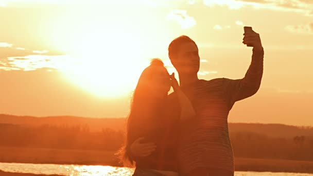 night selfie men and women at sunset slow motion video
