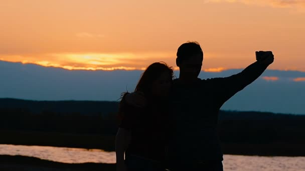 girl and guy photographed silhouette slow motion video