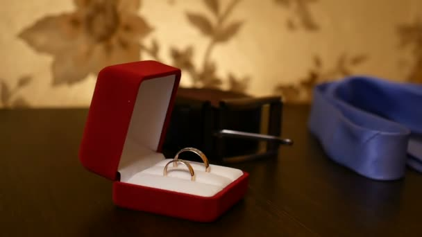 wedding rings in the video red box on the table