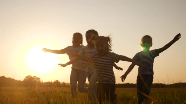happy family children kid together run in the park at sunset silhouette. fun people in the park concept. happy family joyful run. happy family and little baby child summer kid dream concept