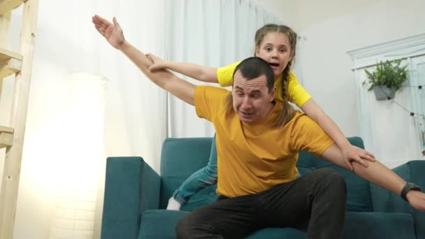 kid a dream. father and daughter play pilot. happy family concept. daughter and dad dream flying to become pilot. child girl play aviator depicts airplane. happy family father stay home and daughter