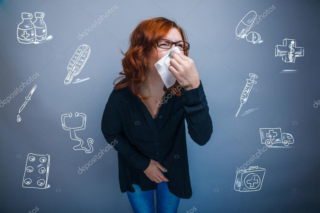 Woman is sick with influenza runny nose sneezing handkerchief in