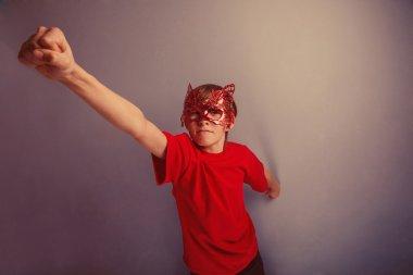 Boy teenager twelve years in  red shirt in  mask, super  hero re