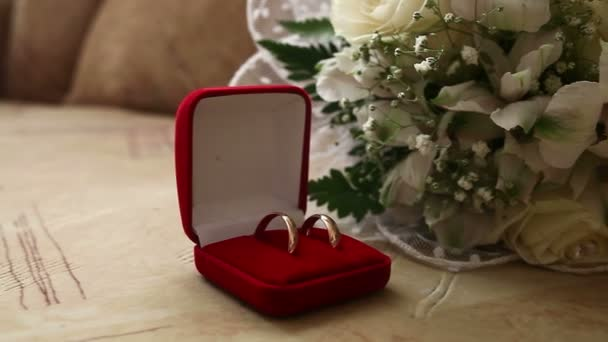 Wedding rings in  the red box in the background bridal bouquet video