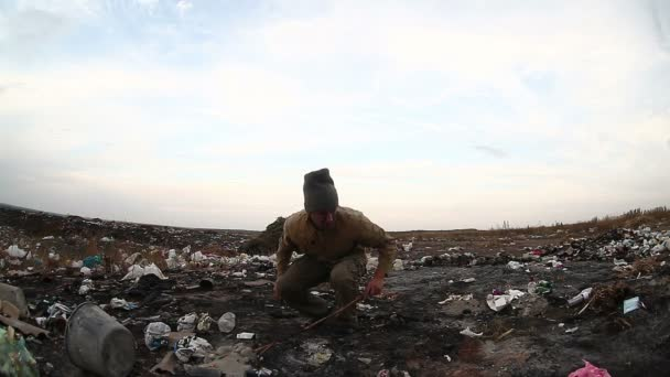 dump unemployed homeless dirty looking food waste in a landfill  social video man
