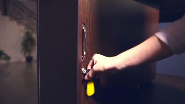 Several girl hotel keys on wooden board reception opens
