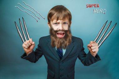 boy superhero teenage beard with razor blade and claw-known comic mask raised his hands above his head
