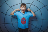 Fotografie Spider man superhero teen boy raised his arms shouting skin stren