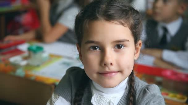 teen portrait girl sitting at a desk in school classroom