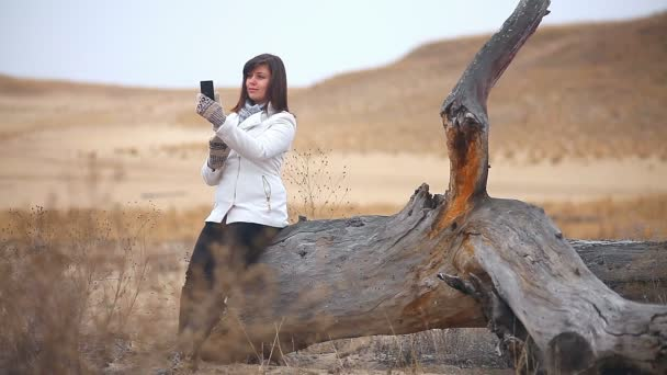 Woman doing self sitting on a dry log nature autumn