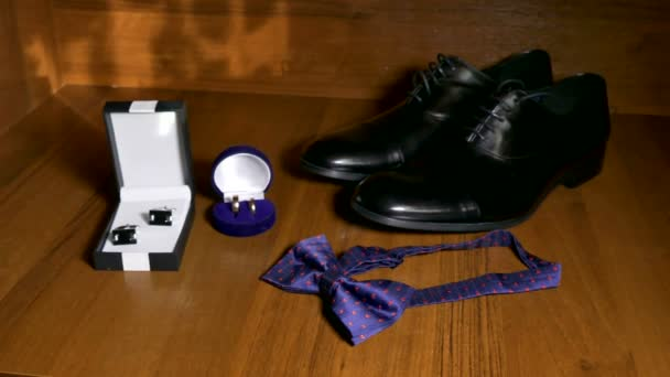 shoes bowtie tie and cufflinks on the table Wedding Accessories