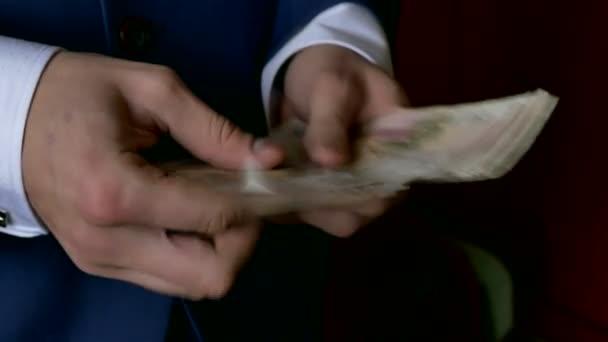 man business man counts money Russian ruble