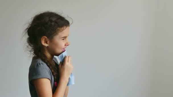 girl teen flu sneezing into a handkerchief influenza virus