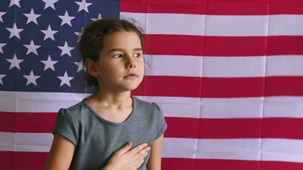 teen usa girl holding hands on the heart  Independence Day American flag Fourth of July