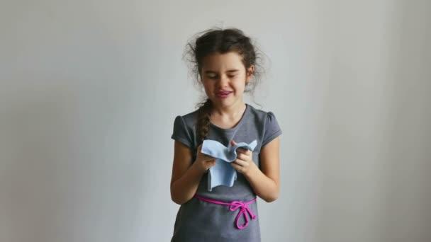 Teenage flu girl sneezing into a handkerchief influenza virus