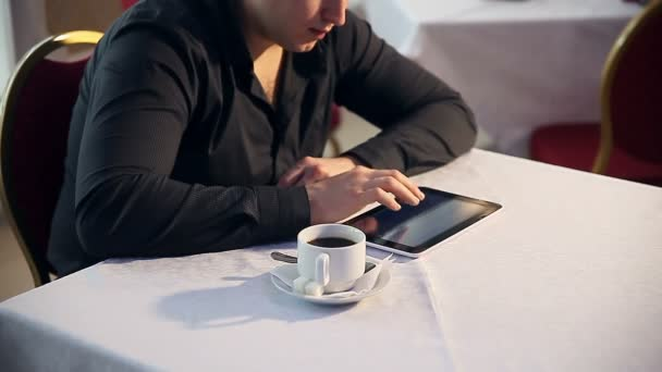 man in cafe with your tablet coffee drinking