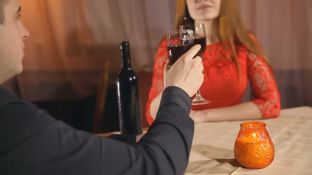 man and woman romantic evening in restaurant love candle Valentines Day drinking wine