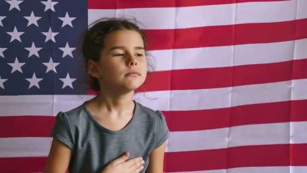 teen girl holding hands on the heart  Independence usa Day American flag Fourth of July
