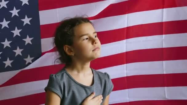 teen girl holding hands on the heart usa  Independence Day American flag Fourth of July