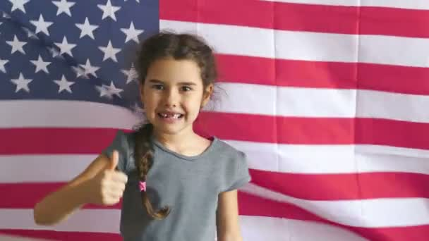 boy teen shows gesture yes Independence Day American usa flag Fourth of July