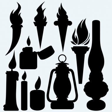 Hot stuff: candle, flaming torches, kerosene lamp and metal zippo lighter