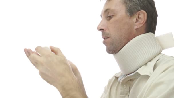 Male In Neck Support Brace Taking Pills