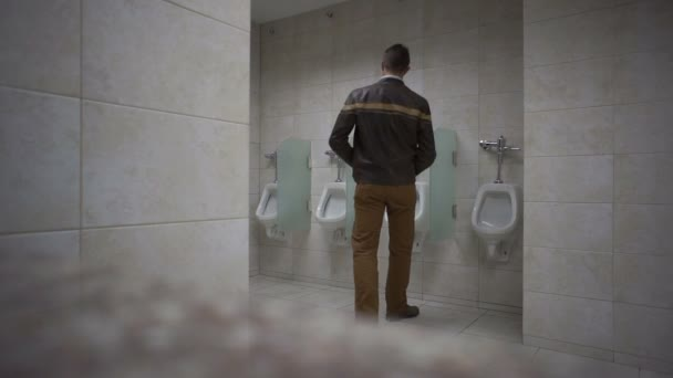 Public Bathroom Man Uses Urinal Stock Video C Cactii 90068160
