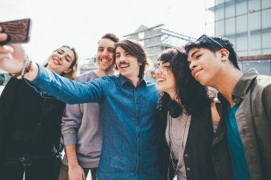Group of multiethnic friends taking a selfie