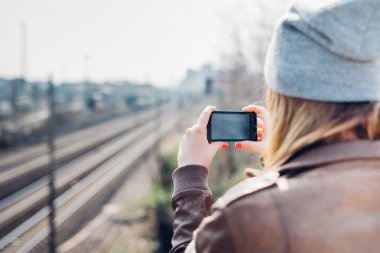 woman taking photo with smart phone