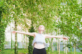 Fotografie Woman feeling free outdoor in park